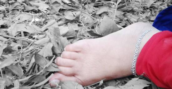 Foot in dry leaves